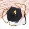 Black hexagonal purse on a chain - Handbags
